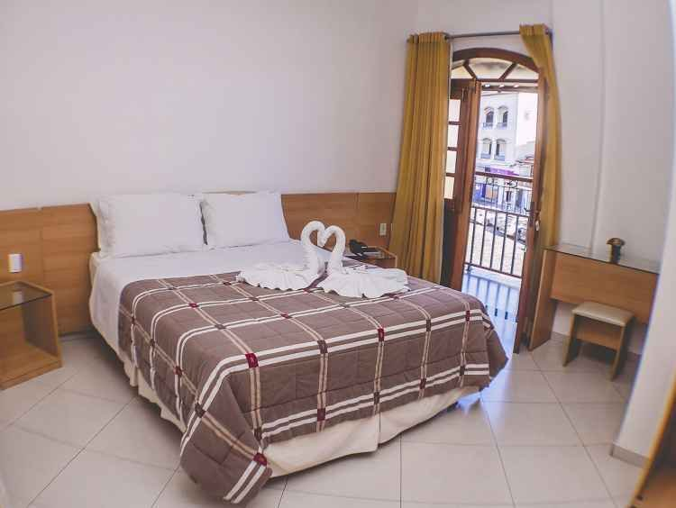 Cama de casal dos Apartamentos Luxo com sacada